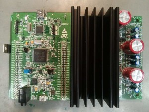The second revision of our board completely assembled withe the microcontroller board and a heatsink mounted on top.